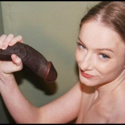 Sasha Grey Enjoys a Black Cock Glory Hole - image  on https://blackcockcult.com