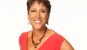 Robin Roberts of Good Morning America smiling in a red dress