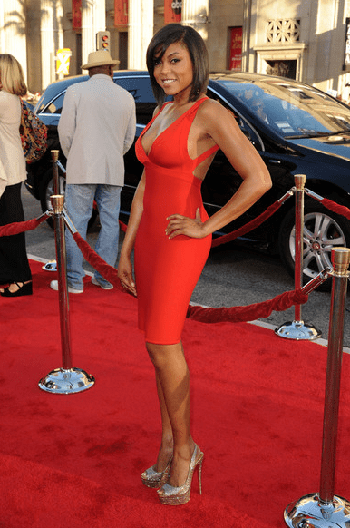 Taraji P. Henson posing in a red dress