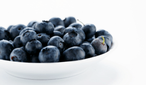 A white bowl filled with blueberries