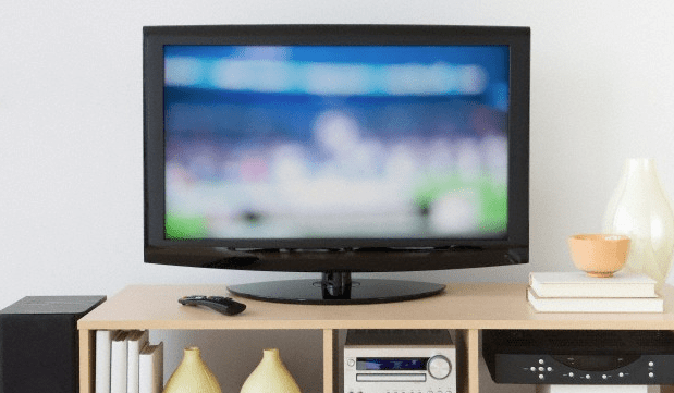 A television sitting on an entertainment stand in the living room