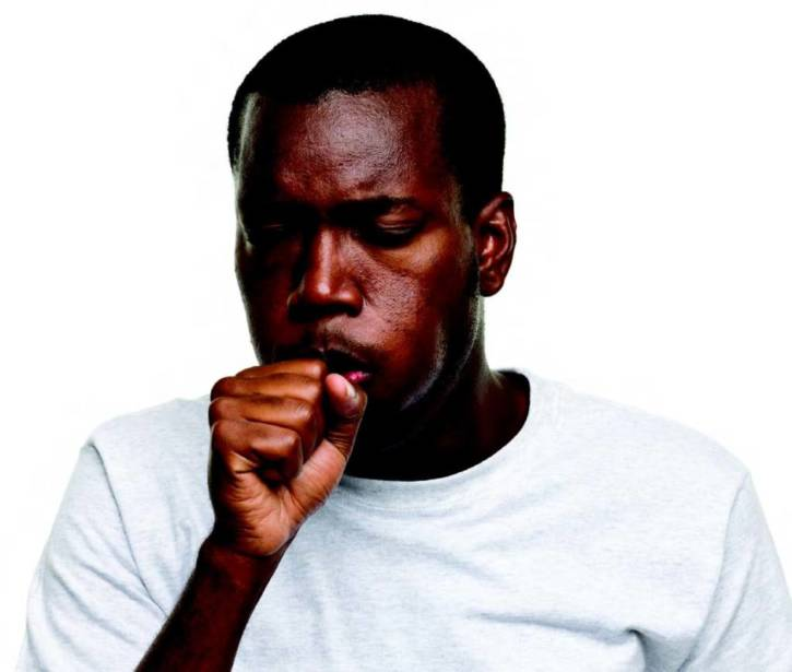 black man coughing
