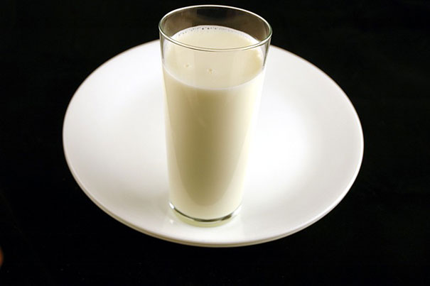 glass of milk on a saucer