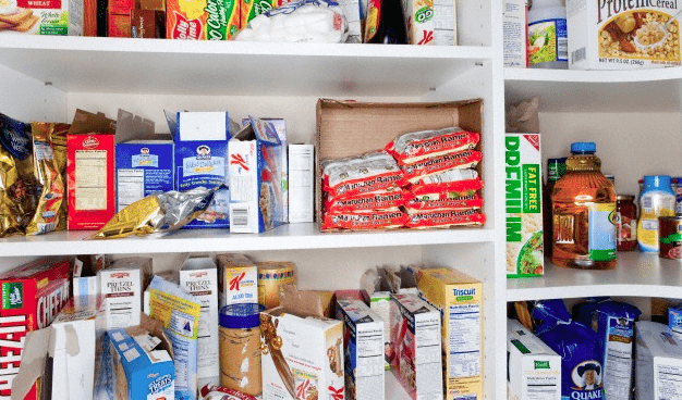 Different processed foods sitting in a kitchen cabinet
