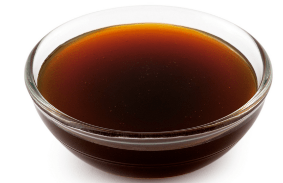 A glass dish filled with yacon syrup