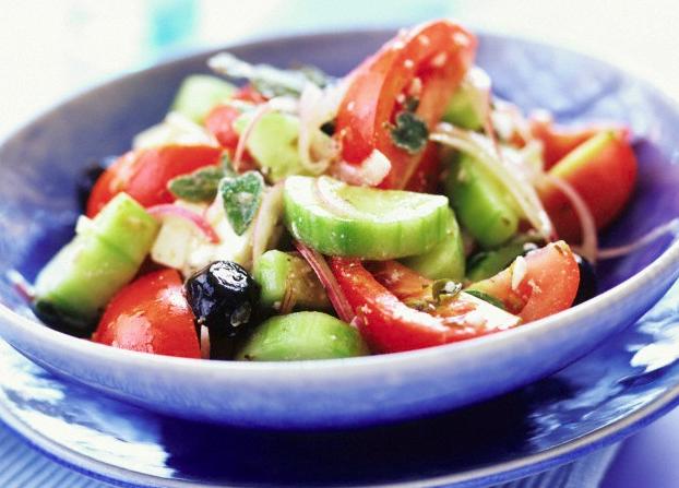 Greek salad in a blue bowl