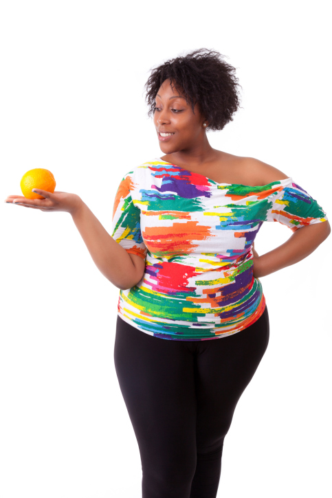 woman overweight with fruit