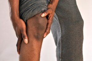 african american man holding knee