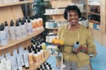 woman with shampoo bottles