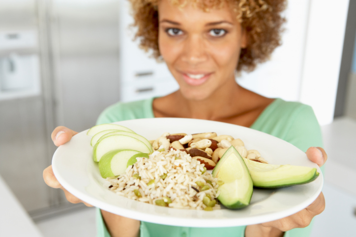 adult woman holding plate of food