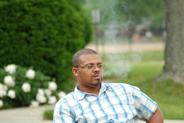 man smoking outside