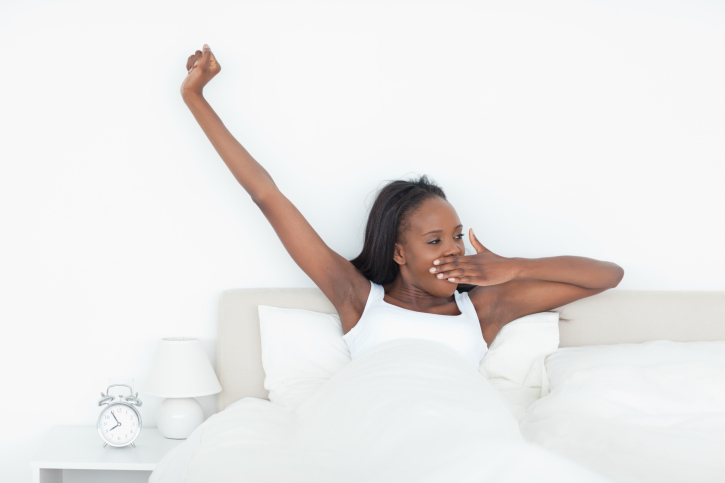 Woman stretching her arms and yawning