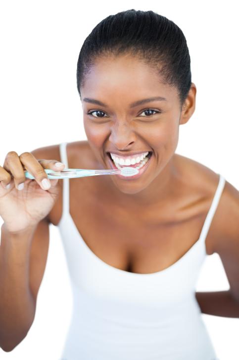 woman smiling brushing teeth