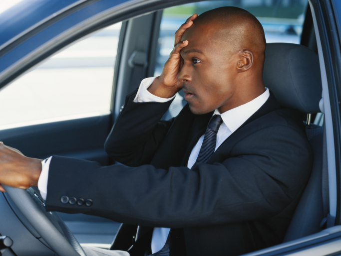man stressed in car