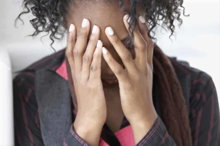woman sad covering face