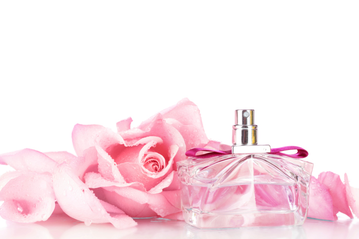 Perfume bottle and pink rose