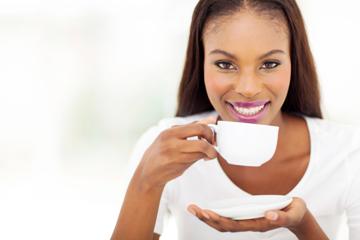 african american woman drinking coffee or tea