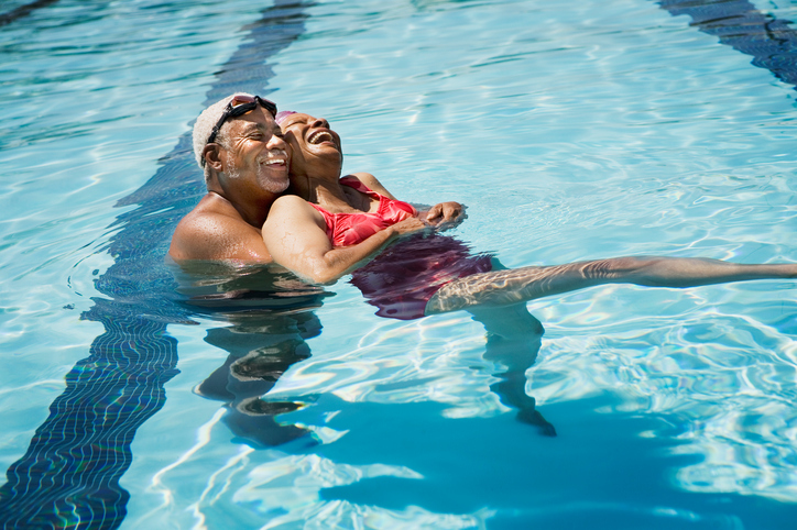 African American senior couple in swimming pool