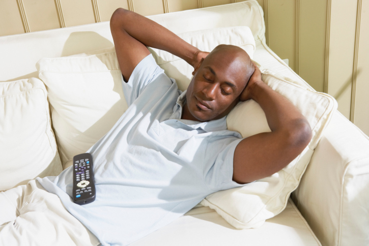 man sleeping on couch relax
