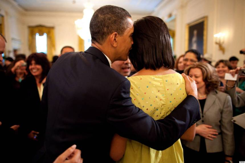 WASHINGTON - MAY 4: In this handout provide by the White House, U.S. President Barack Obama whispers into First Lady Michelle Obama's ear during the White House Cinco de Mayo celebration on May 4, 2009 in Washington, DC. Obama is serving as the 44th President of the U.S. and the first African-American to be elected to the office of President in the history of the United States. (Photo by Pete Souza/White House via Getty Images)