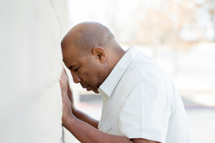 African American older man stressed