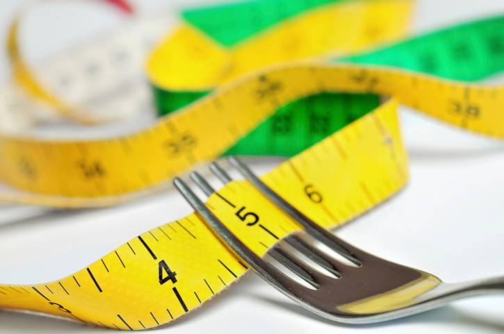 fork with tape measurer