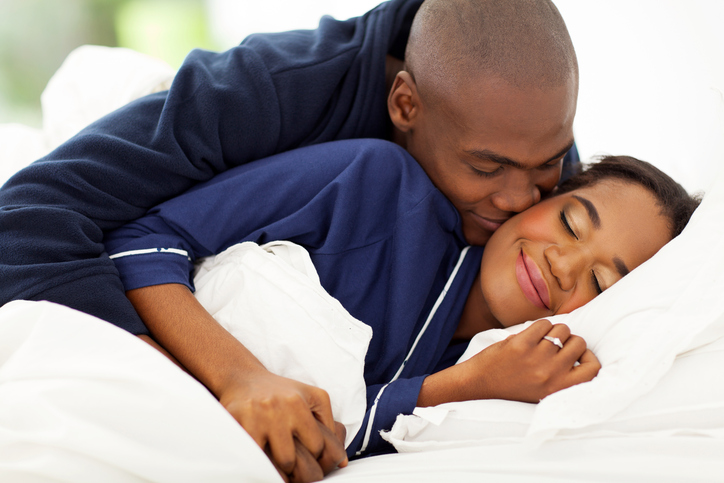 Smiling African American couple in bed