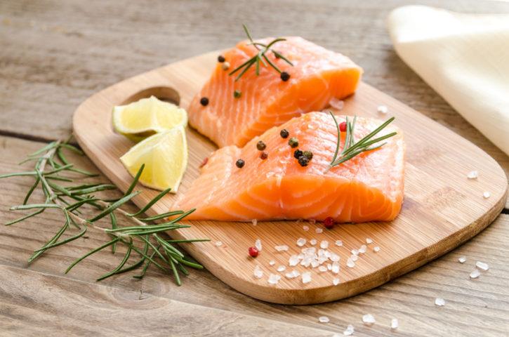 Raw salmon on wood board