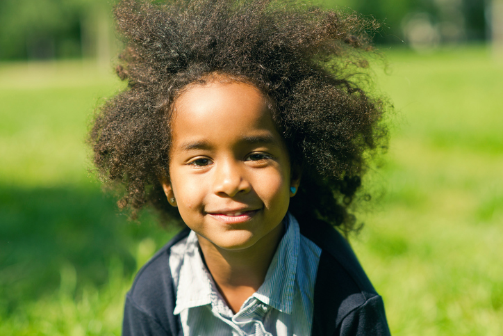 African American child with natural hair outside