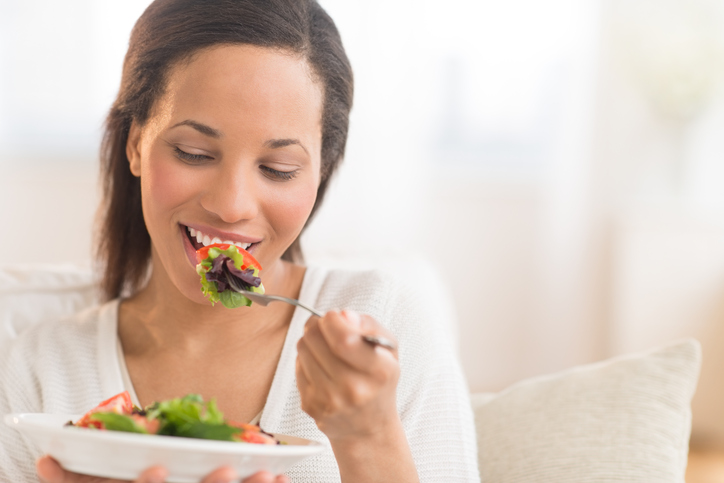 Woman Eating Fresh Salad At Home