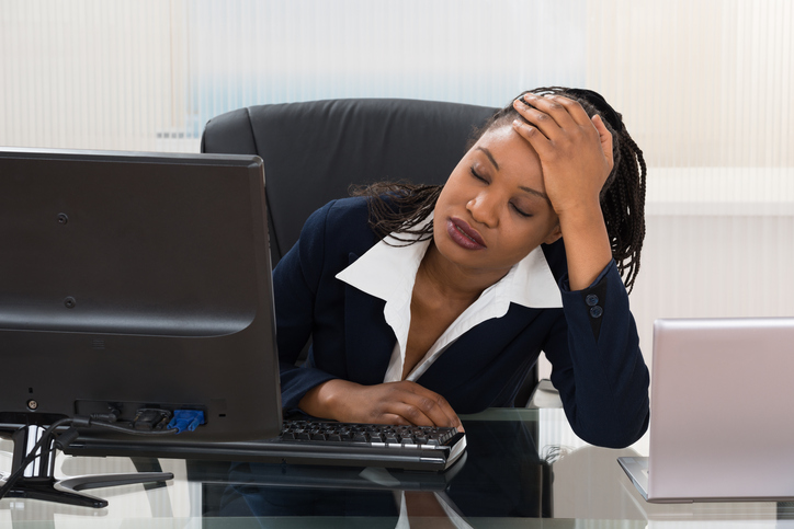 African American woman stressed at work