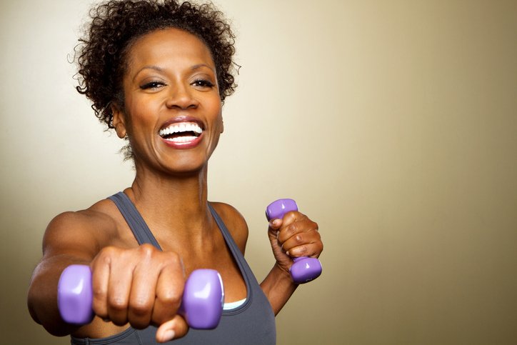 African American woman exercising with weights