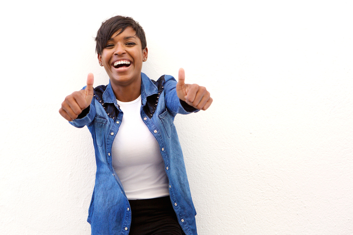 young african american woman happy with thumbs up