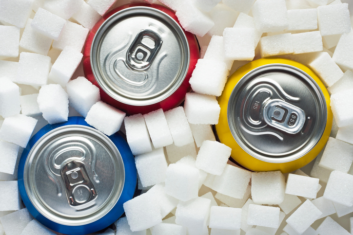 cans of soda and sugar cubes