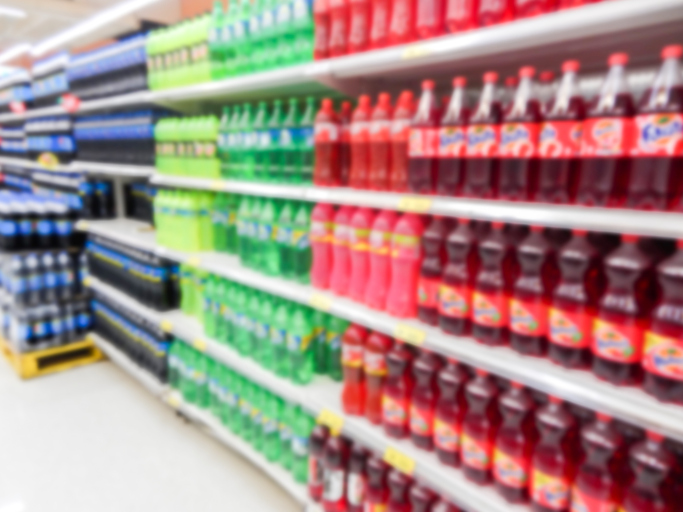 soda aisle in grocery store