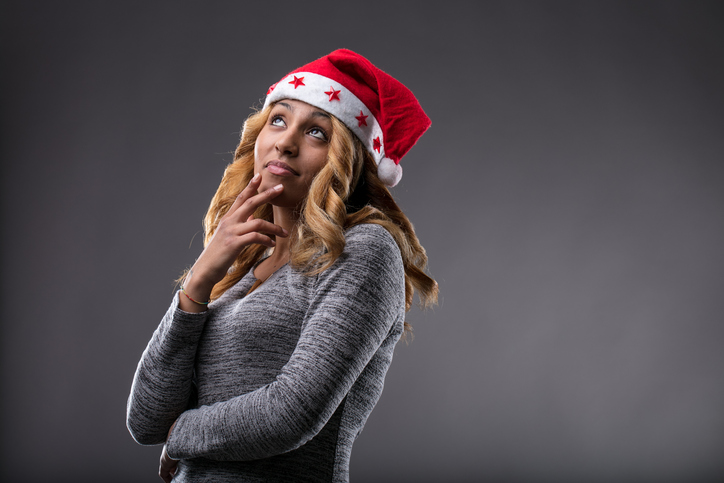 African American woman thinking about Christmas gift