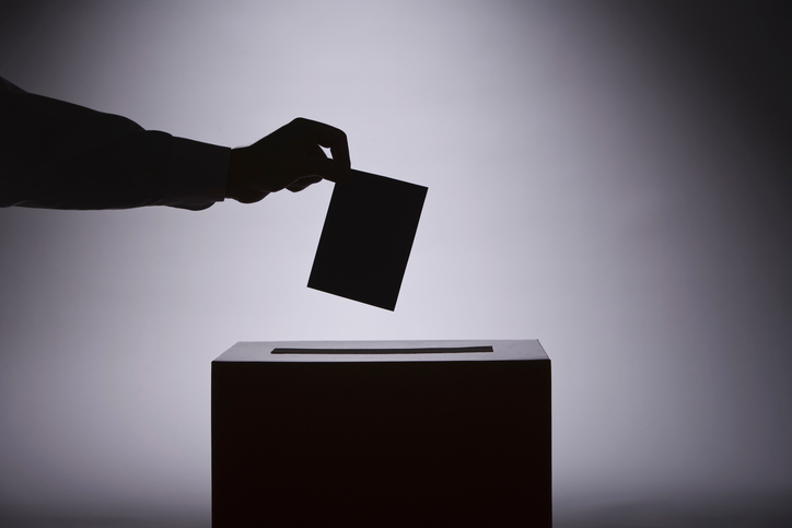 person voting with ballot