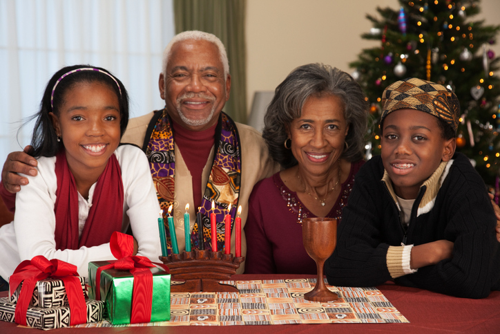 African couple with grandchildren celebrating Kwanzaa