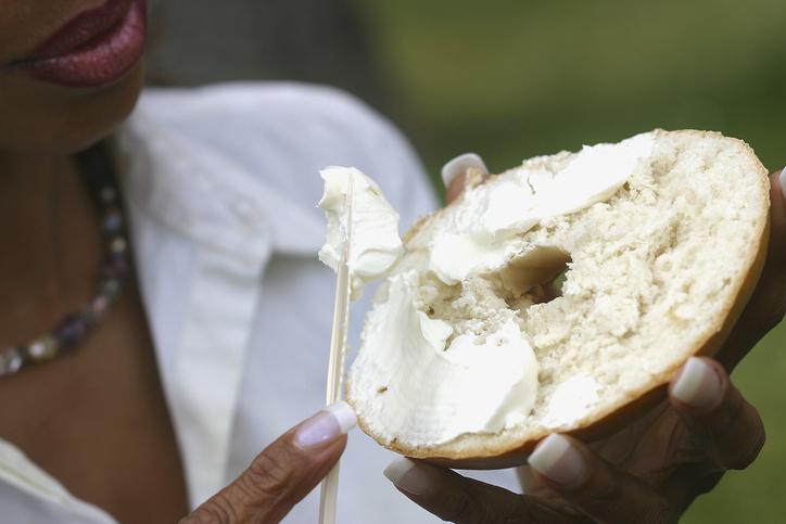 African american woman eating bagel