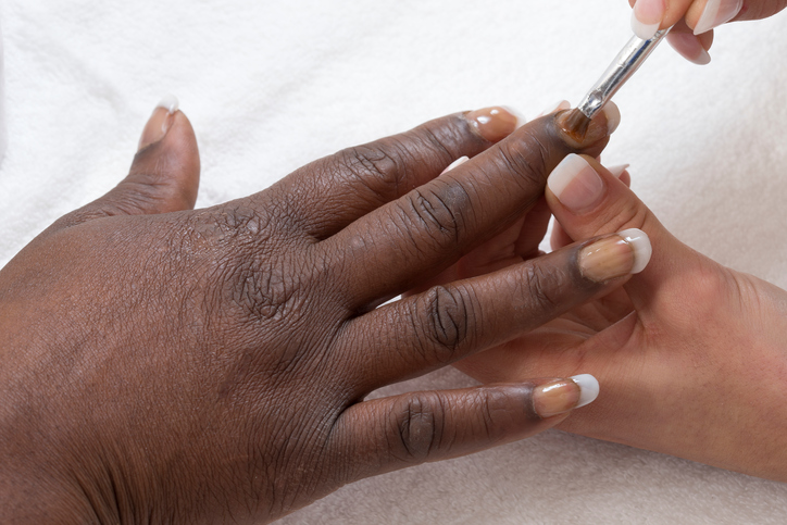 African American woman getting nails done