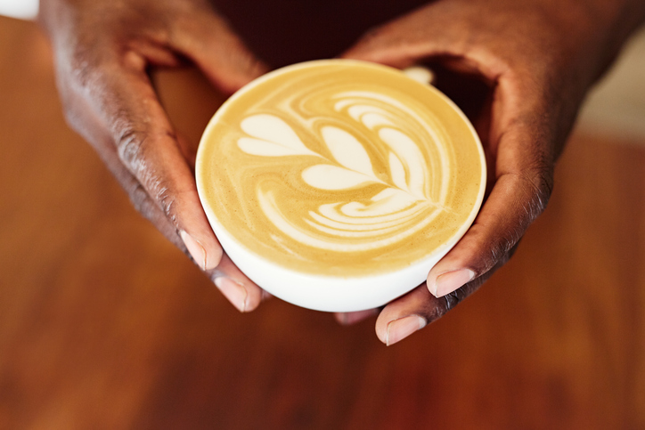 African American hands holding a coffee