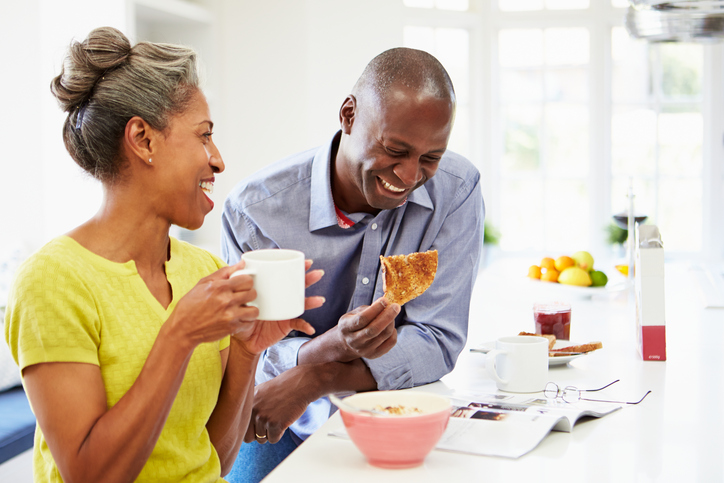 African American couple eating breakfast