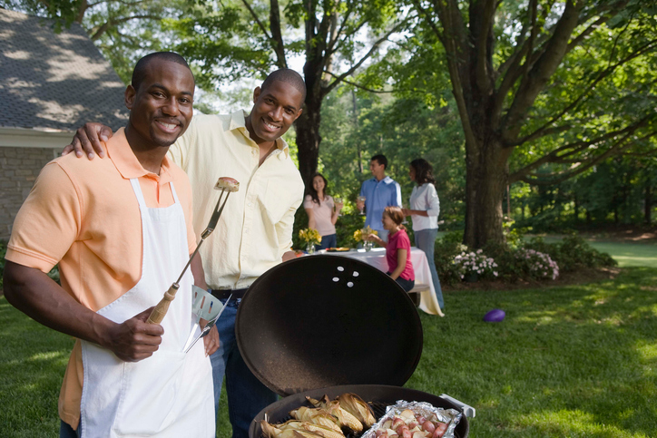 African American men grilling at BBQ