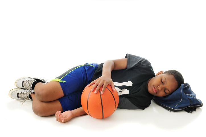 African American boy tired sleeping