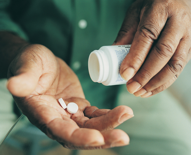African American man taking medicine pills
