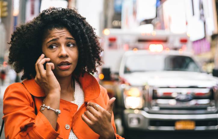 African american woman calling 911 emergency