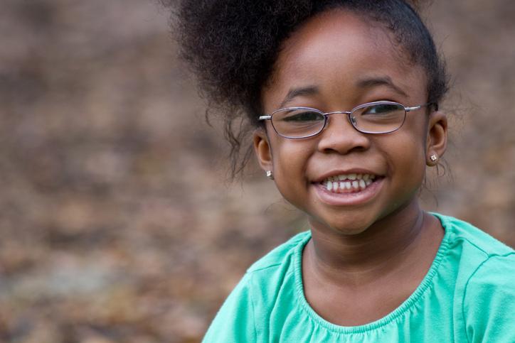 African American girl wearing glasses