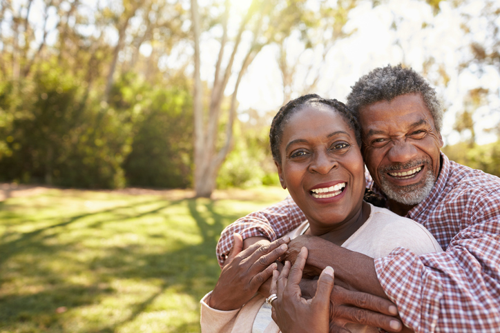 Older African American couple outside in park