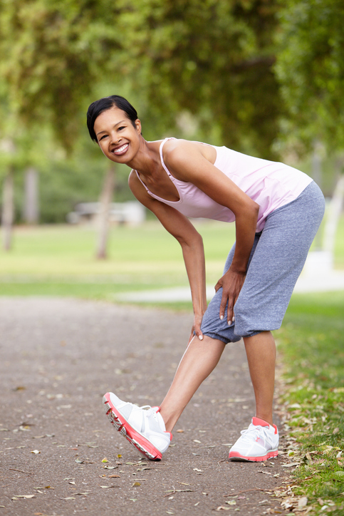 African American woman exercising outside