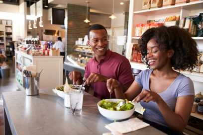 African American couple eating in restaurant